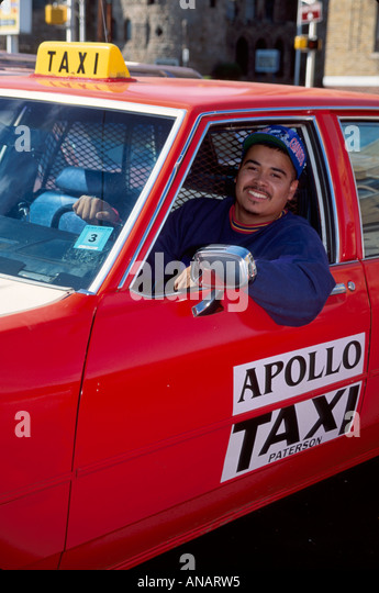 New Jersey Paterson taxi cab driver Hispanic man job driver public transportation - Stock Image