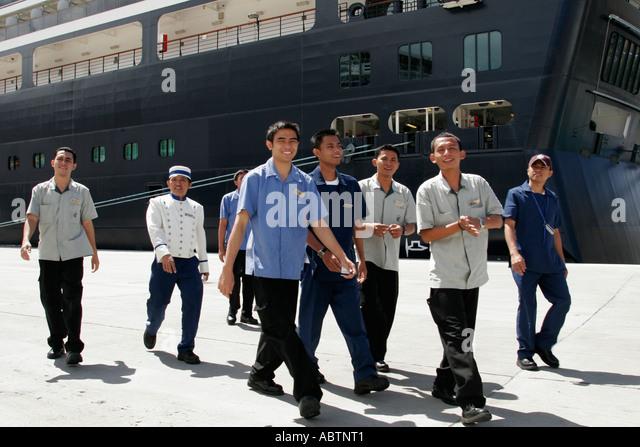 St. Thomas USVI Crown Bay Holland America Line ms Noordam Asian male crew walk to US Customs Inspection - Stock Image