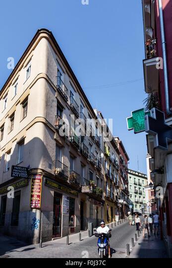 Spain Europe Spanish Madrid Centro Lavapias Calle de la Fe city skyline buildings narrow street - Stock Image
