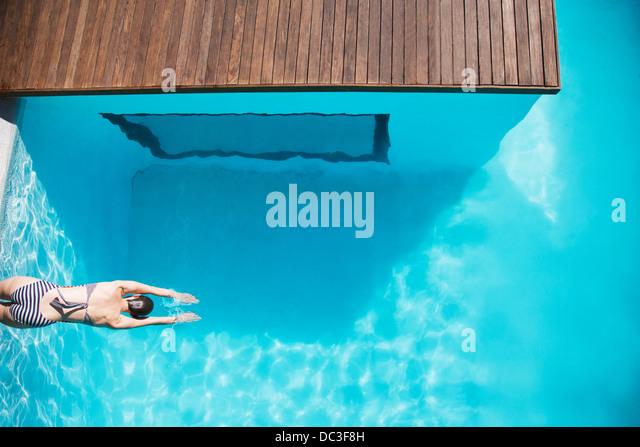 Woman in luxury swimming pool - Stock Image