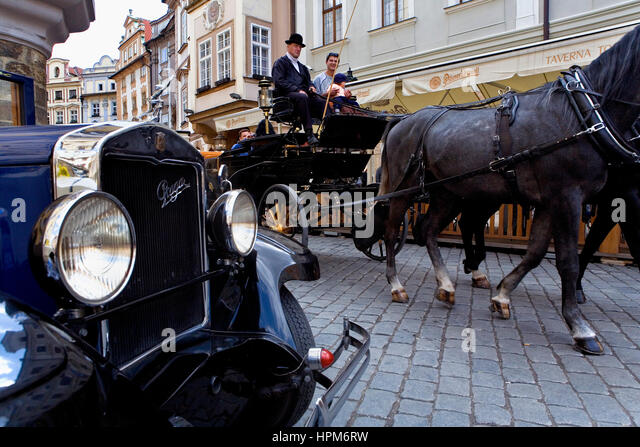 Sightseeing tours in old Prague, by cars of epoch and carriage. Malé mamèstí square.Prague. Czech - Stock-Bilder