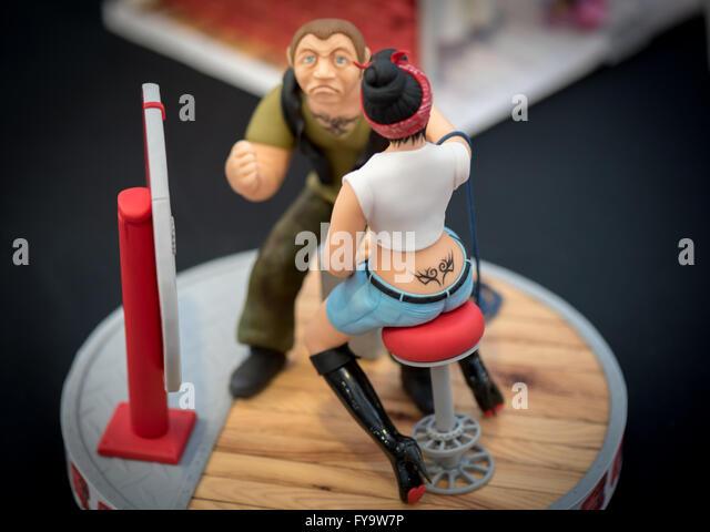 Tattoo studio woman and man cake decorations at Cake International ? The Sugarcraft, Cake Decorating and Baking - Stock-Bilder