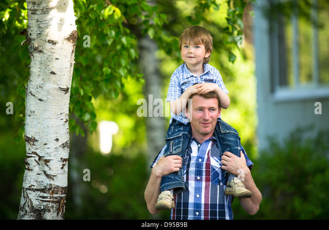 Portrait of father and son outdoors - Stock Image