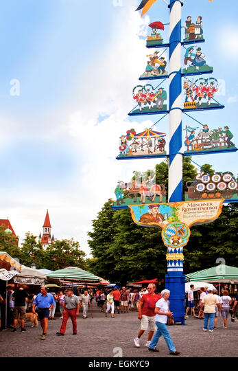 MUNICH, GERMANY; local buyers and tourists near the May pole landmark of Viktualienmarkt, open air market of food - Stock Image