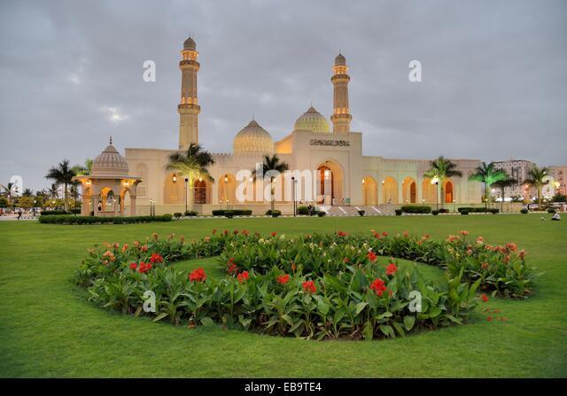 Sultan Qaboos Mosque at dusk, classical Medina architecture, Salalah, Orient, Oman - Stock Image