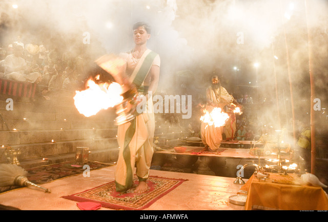 Hindu holy men performing religious ceremony puja Varanasi India - Stock-Bilder