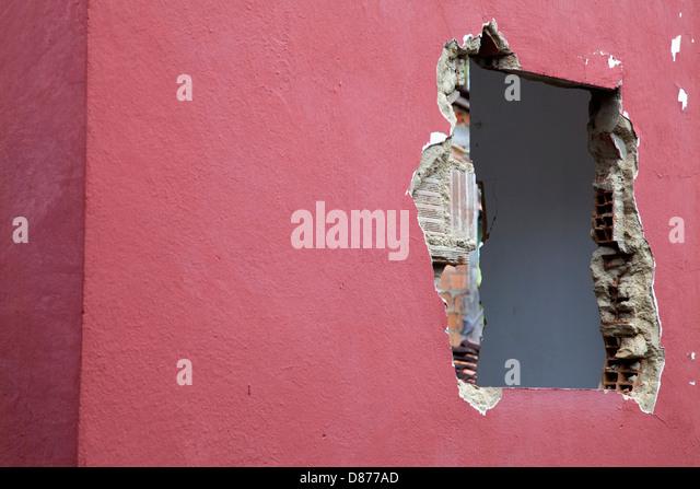 Brazil, Bahia, Hole on wall - Stock Image