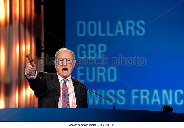 UK, auctioneer Charlie Ross at the Gooding & Company 2011 Scottsdale Collector Car Auction, with currency conversions - Stock Image