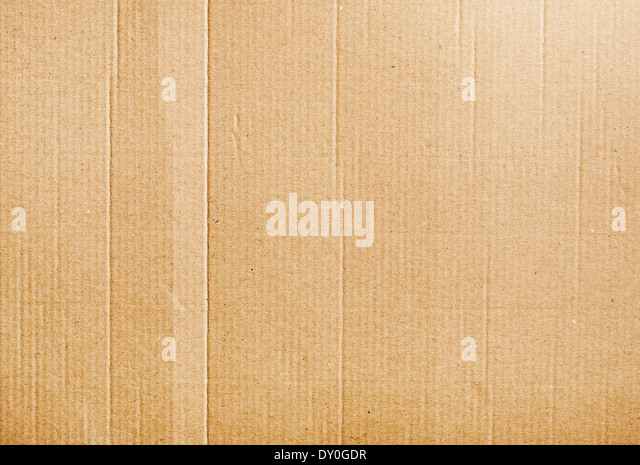 Corrugated cardboard background texture with some wrinkles - Stock Image