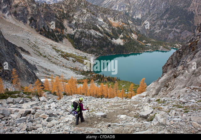 Backpacker Descending Aasgard Pass Towards Colchuk Lake, Enchantments, Alpine Lakes Wilderness, Washington State, - Stock Image
