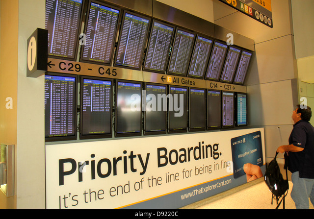 Texas Houston George Bush Intercontinental Airport IAH concourse gate area arrivals departures timetable schedule - Stock Image