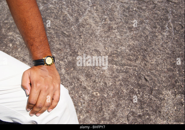 Stylish Hand in blurred Hard Rock background - Stock Image