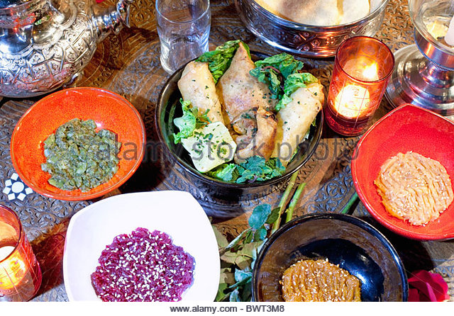 Traditional moroccan dishes with candles. - Stock Image