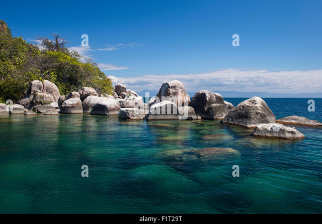 Turquoise clear water and granite rocks, Mumbo Island, Cape Maclear, Lake Malawi, Malawi, Africa - Stock Image