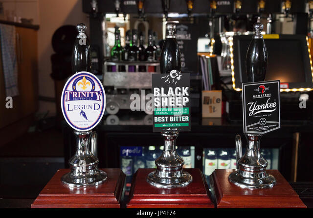Beer pumps in a local pub, Sowerby Bridge, West Yorkshire - Stock Image