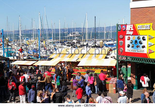 California San Francisco The Embarcadero Pier 39 entertainment Fisherman's Wharf water shopping NFL Shop business - Stock Image