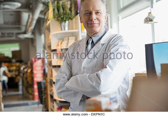Portrait of pharmacist in market - Stock Image