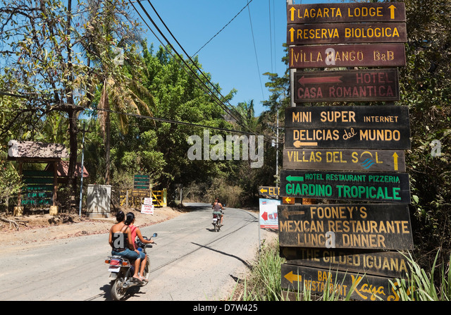 Signs for tourists near popular Playa Guiones beach, Nosara, Nicoya Peninsula, Guanacaste Province, Costa Rica - Stock Image