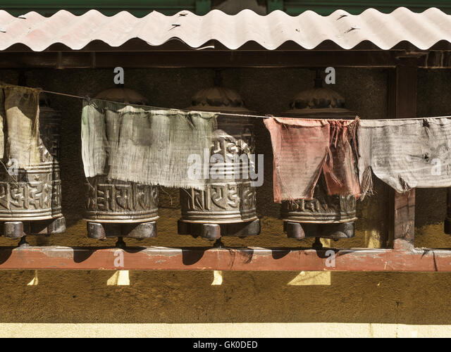 Boudhanath Stupa prayer wheels and flags - Stock Image