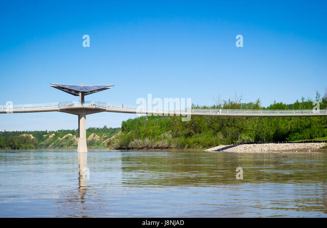 A view of the Terwillegar Park Footbridge, a stressed ribbon bridge spanning the North Saskatchewan River in Edmonton, - Stock Image