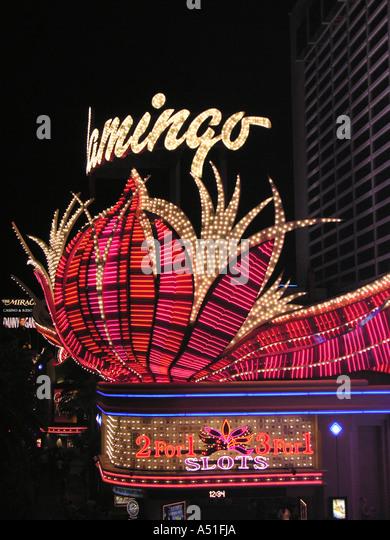 Las Vegas strip night Flamingo hotel casino sign bright neon lights landmark building architecture - Stock Image
