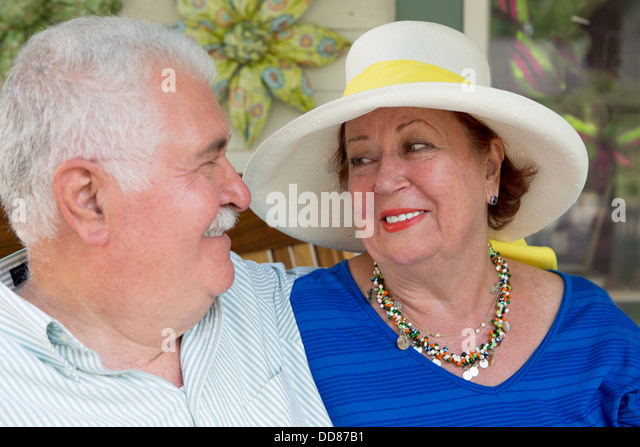 Some marriages last longer when you don't take the life too serious. Senior couple looking at each other. - Stock Image