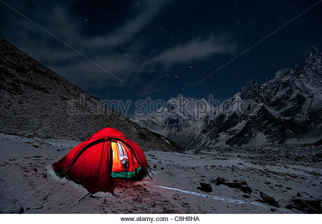 Camped out beneath the Larke La pass on the Manaslu circuit trek. - Stock Image