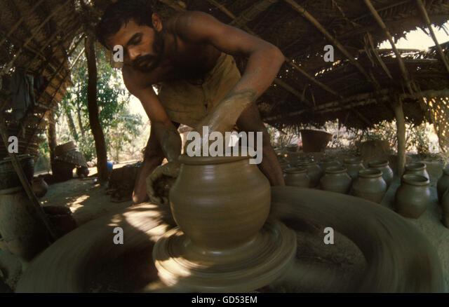 Man making earthen pots - Stock Image