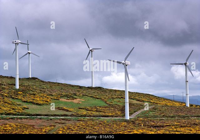 Wind turbines on the Atlantic coastline near Camariñas in Spain's Galicia region. - Stock Image