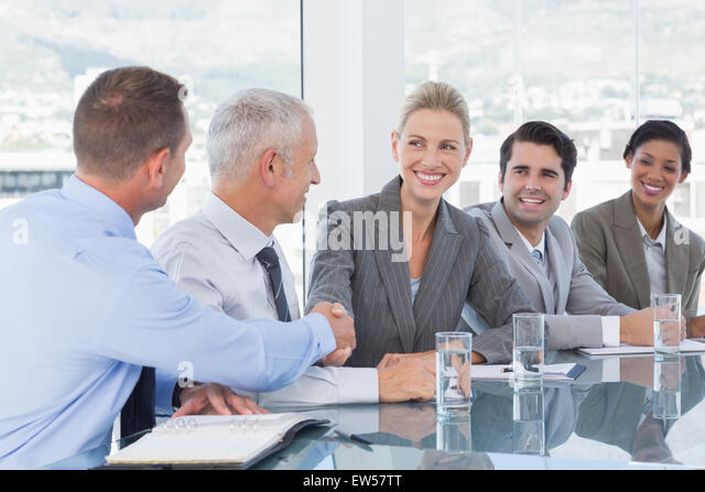 Business people shaking their hands - Stock Image