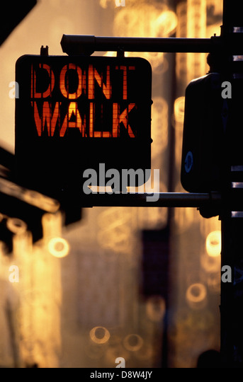 Red pedestrian crossing light with words Don't Walk, New York, NY, USA - Stock Image