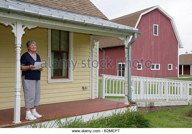 Indiana Portage Countryside Park Alton Goin Historical Museum regional history restore Samuelson farmhouse woman - Stock Image