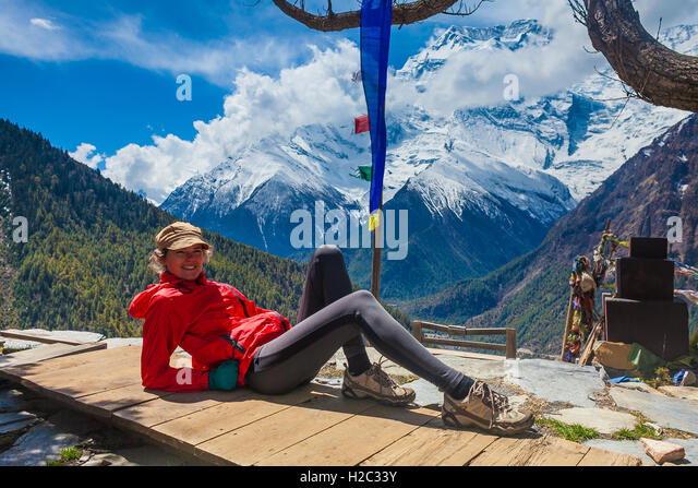 Beautiful Woman Traveler Backpacker Take Rest Mountain Terrace Village.Young Girl Posing Smiling Camera.North Snow - Stock Image
