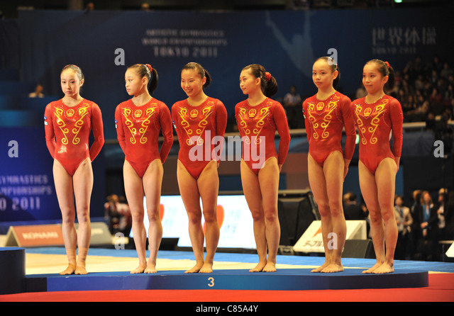Team China (CHN) line-up during the 2011 Artistic Gymnastics World Championships. - Stock Image