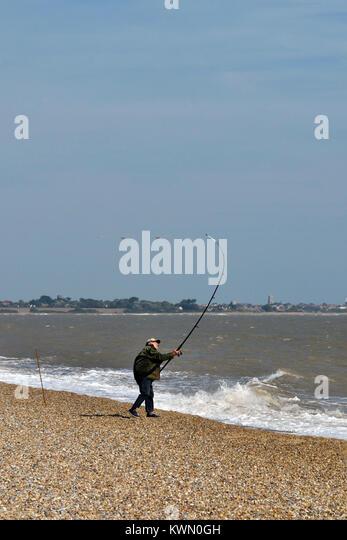 beach casting off dunwich beach suffolk uk - Stock Image