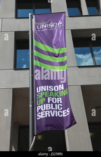 A flag flying outside the headquarters of the trade union, Unison, on the the Euston Road, London - Stock Image