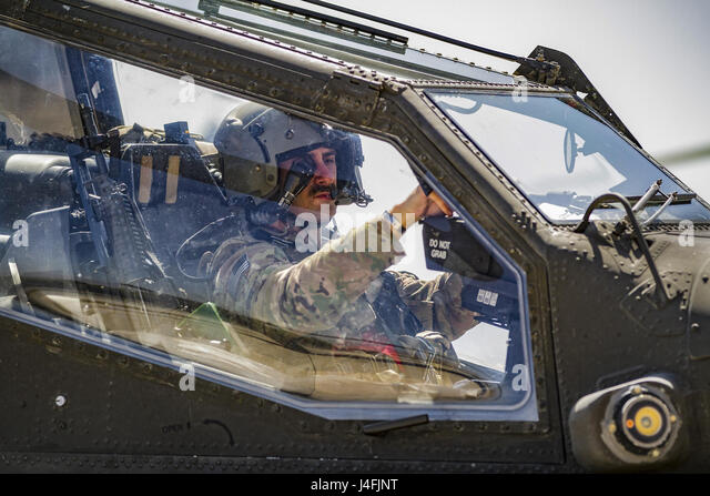 An Army AH-64E Apache helicopter pilot prepares to depart for a mission from Jalalabad Airfield, Afghanistan, April - Stock Image