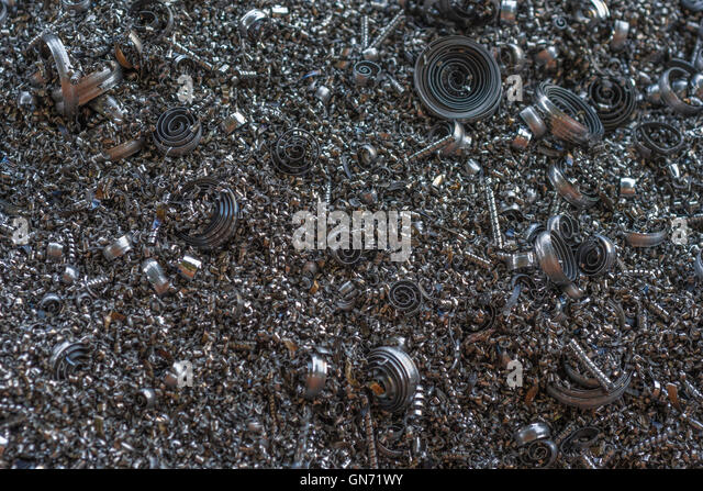 Close shot of metal turnings / industrial swarf from CNC machining operations. - Stock Image