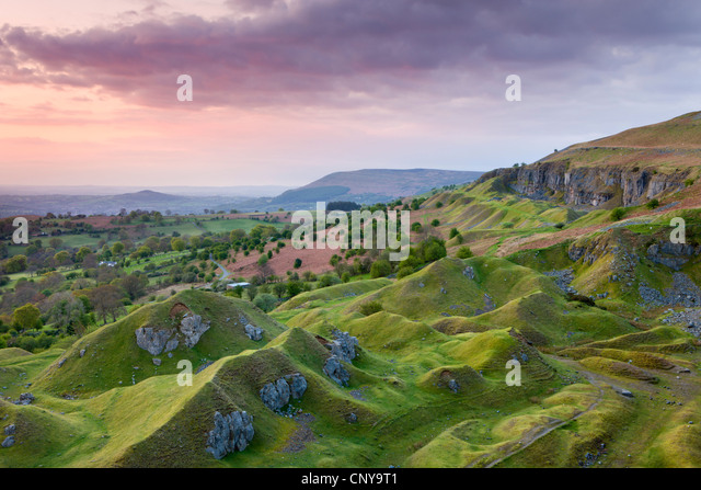 Sunrise over the abandoned quarry works on the Llangattock Escarpment, Brecon Beacons National Park, Powys, Wales - Stock Image