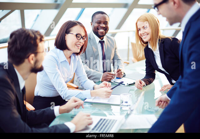 Positive business team working at office - Stock Image