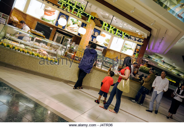 Palm Beach Florida Gardens The Gardens Mall food court shopping center centre suburban indoor man woman boy mother - Stock Image