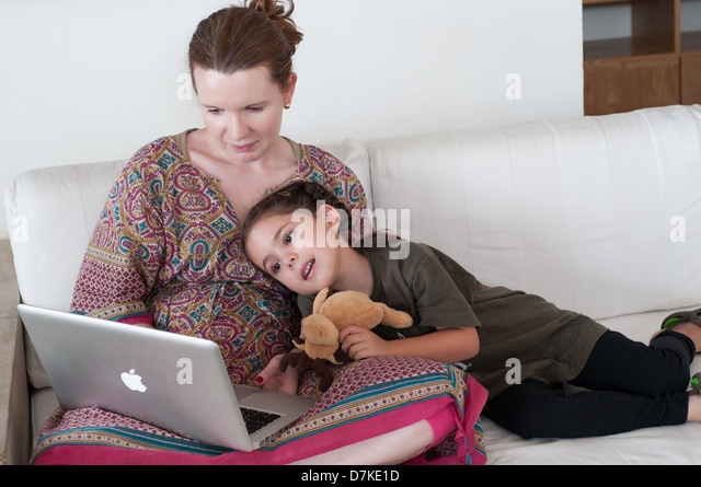 Woman and Child with laptop - Stock Image