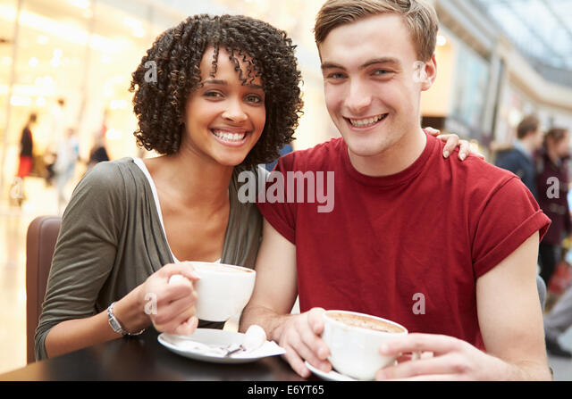 Young Couple Meeting On Date In Café - Stock-Bilder