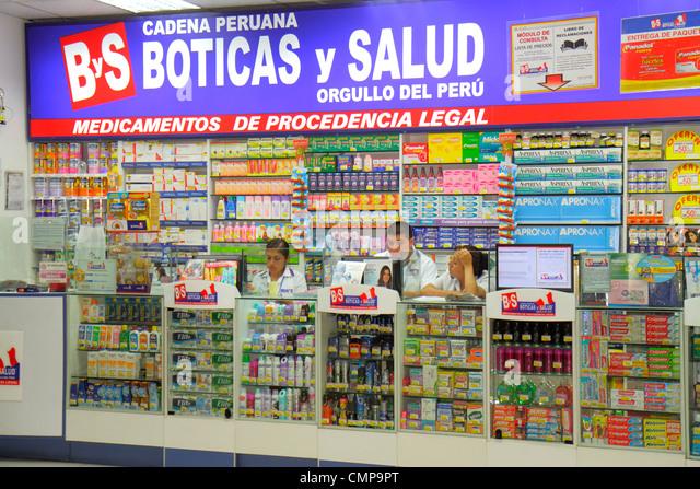 Peru Lima Estacion Central station Metropolitano Bus Line transportation hub shopping Boticas y Salud pharmacy drug - Stock Image