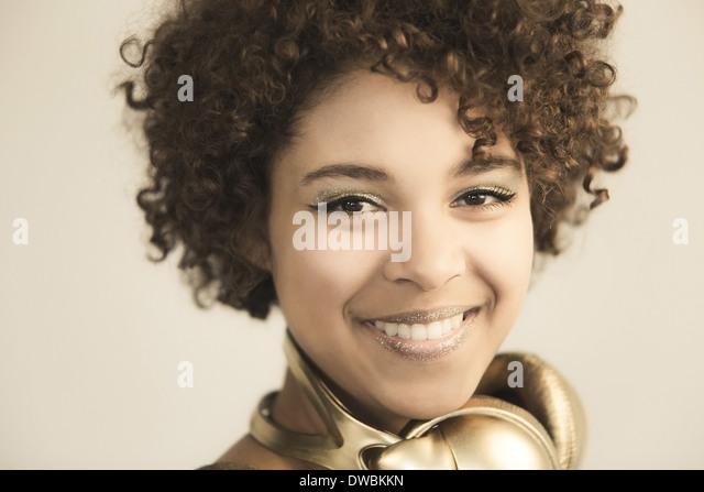 Portrait of female Afro-American with headphones - Stock-Bilder