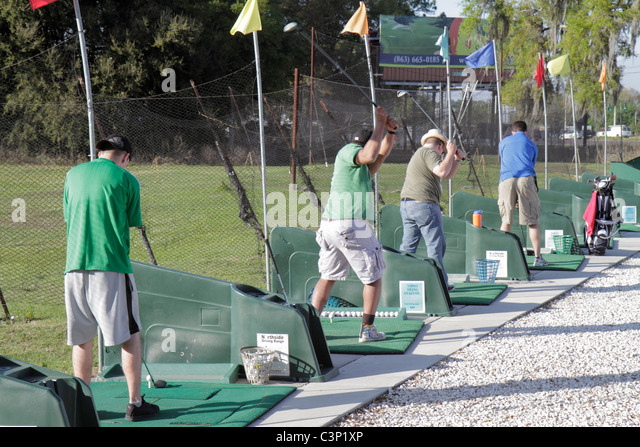 Lakeland Florida golf driving range practice players sports swing swinging hitting balls - Stock Image