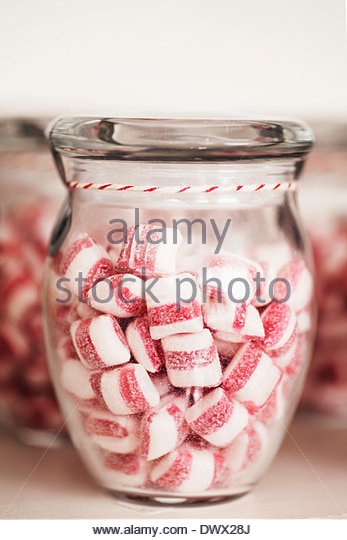 Candies in jars on table - Stock Image