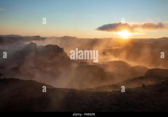Sunrise over the smouldering lava field at Leirhnjukur, Krafla volcano, Myvatn, Nordhurland Eystra, Iceland. - Stock Image