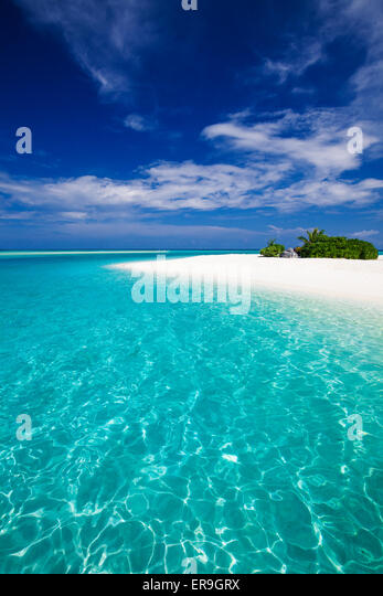 The most amazing beach on a tropical island with a rock - Stock Image