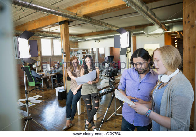 Creative business people preparing to film tutorial - Stock Image